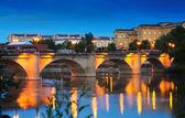 Ancient stone bridge over Ebro  in evening. — Stock Photo