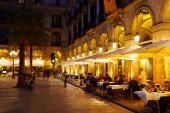 Restaurants at Placa Reial in winter evening. — Stock Photo