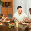 Family eating spaghetti — Stock Photo #54982423
