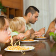 Family eating spaghetti — Stock Photo #54982479