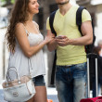 Couple with GPS navigator and baggage — Stock Photo #54982525