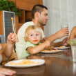 Family of four having lunch with pasta — Stock Photo #54982585