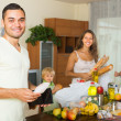 Family of four with bags of food — Stock Photo #54982717
