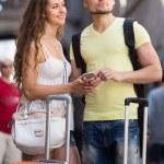 Couple with GPS navigator and baggage — Stock Photo #54982731
