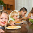 Family eating spaghetti — Stock Photo #54982797