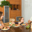 Family of four eating spaghetti — Stock Photo #54982809