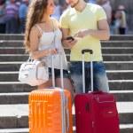 Couple with GPS navigator and baggage — Stock Photo #54982911