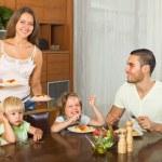 Family of four eating spaghetti — Stock Photo #54982993