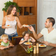 Family of four eating spaghetti — Stock Photo #54983051