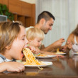 Family eating spaghetti — Stock Photo #54983071