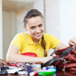 Happy girl founded thing in handbag — Stock Photo #54989643