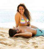 Happy  couple having  date at sandy beach  — Stock Photo