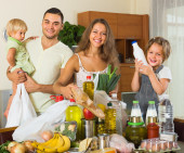 Parents and children with food — Stock Photo