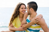 Happy twosome having romantic date on sandy beach — Stock Photo