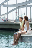 Couple taking sunbath on the pier — Stock Photo