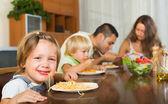 Family eating spaghetti — Stock Photo
