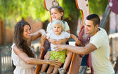 Family of four at playground — Foto de Stock