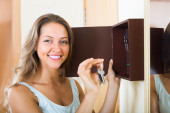 Smiling woman with key  — Stock Photo