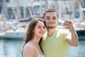 Couple doing selfie at sea port — Stock Photo