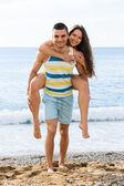 Happy two having romantic date on sandy beach — Stock Photo