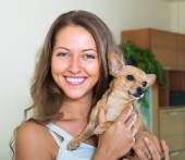 Smiling girl with Russkiy Toy Terrier — Stock Photo