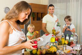 Poor family with bags of food — Stockfoto