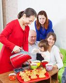 Mature woman pours tea — Stock Photo