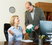 Office manager congratulating secretary — Stock Photo