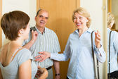 Woman meeting mature friends — Stock Photo
