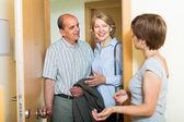 Daughter greeting parents at threshold — Stock Photo