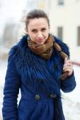 Woman  wearing  coat at wintry city  — Stock Photo