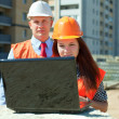 Two architects works in front of building site — Stock Photo #54990399