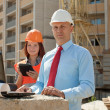 Two architects works in front of building site — Stock Photo #54990459
