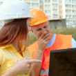 Two architects works in front of building site — Stock Photo #54990565
