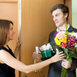 Young man giving gifts to woman — Stock Photo #54992193