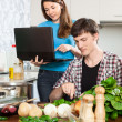Nice girl shows the new recipe — Stock Photo #54992713