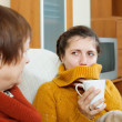 Woman caring for her adult daughter has cold — Stock Photo #54994049