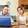 Couple looking in laptop — Stock Photo #54994499