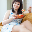 Ordinary woman eats vegetables — Stock Photo #54995005
