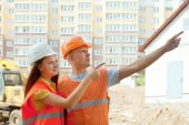 Builders standing at building site — Stock Photo