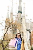 Woman   with purchases against Sagrada familia  — Stock Photo