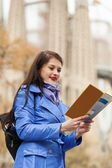 Woman looking at the map — Stock Photo