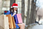 Woman with purchases at street — Stock Photo