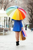 woman  with purchases and umbrella at street — Stock Photo