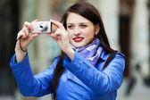 Happy girl with digital camera — Stock Photo