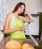 housewife thinking what to prepare for dinner   — Stock Photo