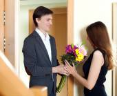 Husband present flowers to his young wife — Stock Photo