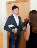 Man smiling and give bunch of flowers to his wife — Stock Photo