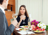 Young women having romantic dinner with her husband — Stock Photo
