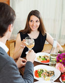 Woman having romantic dinner with guy  — Stock Photo